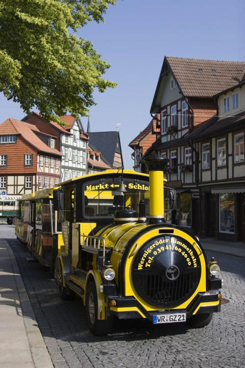 Urban train carries tourists to the castle.