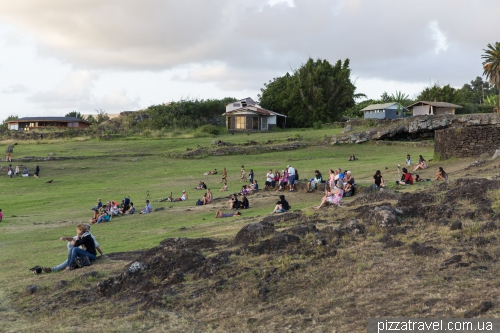 Tourists wait for the sunset near Ahu Tahai