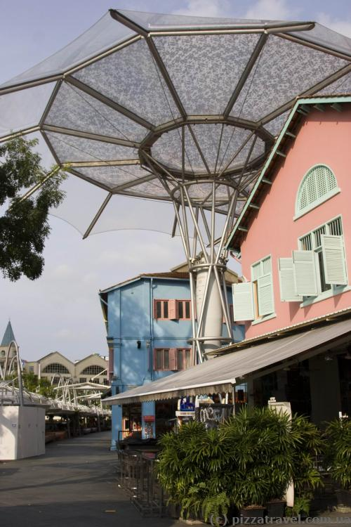 Clarke Quay is covered with sun umbrellas